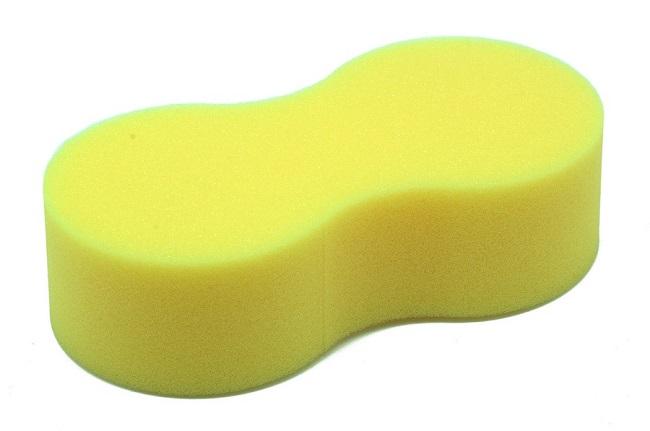 Esponja amarela feita de espuma flexível de poliuretano.